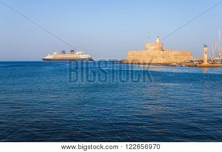 Greece, Rhodes - July 19 Cruise ship on the background of the fortress of St. Nicholas on July 19, 2014 in Rhodes, Greece