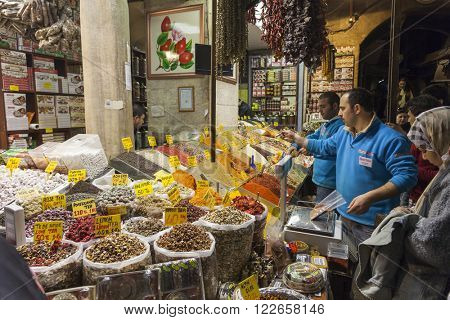 ISTANBUL, TURKEY - MARCH 19, 2011: People shopping in the Egyptian Bazaar also known as Spice Bazaar. This is one of the largest covered markets  in city and is the center for spice trade.