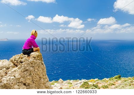 Success achievement running hiking or climbing accomplishment woman relaxing and looking at view trekking or trail running outdoors. Motivation and inspiration in beautiful landscape view.