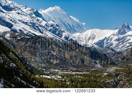 Inspirational Landscape in Himalaya Mountains. Annapurna Range on Annapurna Circuit Trek Beautiful Mountains and Views. Looking at Humde village and Tilicho Peak 7134m in Nepal Asia.