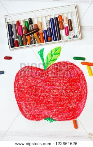 photo of a colorful drawing - big red apple