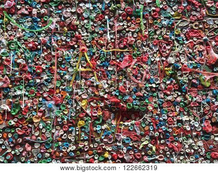 SEATTLE, WASHINGTON - March, 2016. The Market Theater Gum Wall is a brick wall covered in used chewing gum. It is located in Post Alley under Pike Place Market, a popular tourist destination in downtown Seattle.