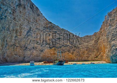 ZANTE ISLAND, GREECE - CIRCA JUNE 2015: Tourist Boats in Navagio Bay with Pirate's Shipwreck, view from the sea