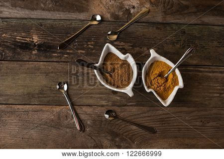 curcuma and curry herbs with the spoons arround