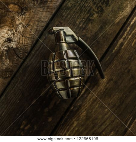 hand grenade on wood background