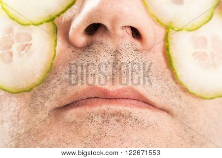 Close-up of mature man with face pack cucumber France