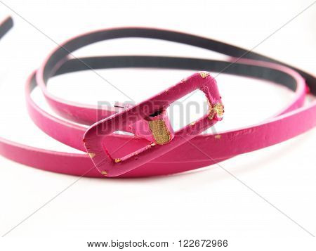 Scratched leather pink, old belt accessory for woman, isolated on white background