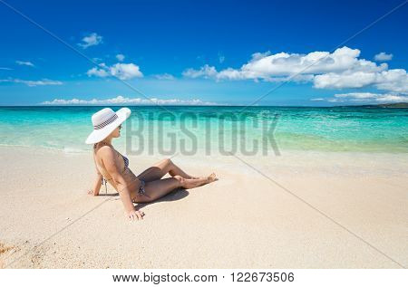 Young woman relaxing on the tropical beach. Boracay island, Philippines