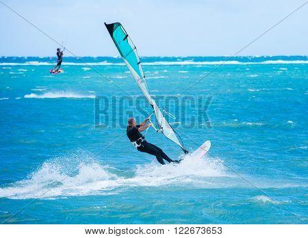 Boracay island, Philippines - January 26: windsurfer enjoying wind power on Bulabog beach on January 26, 2016, Boracay island, Philippines.