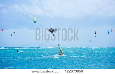 Boracay island, Philippines - January 25: kitesurfers and windsurfers enjoying wind power on Bulabog beach. Extremal rider performing kite loop on January 25, 2016, Boracay island, Philippines.