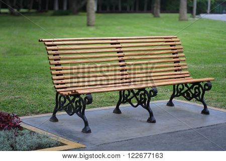 a wooden bench seat at a park