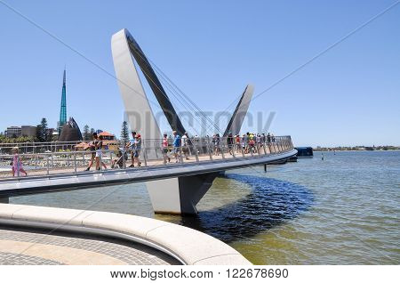 PERTH,WA,AUSTRALIA-FEBRUARY 13,2016: The Elizabeth Quay suspension pedestrian bridge with tourists over the artificial inlet on the Swan River in Perth, Western Australia.