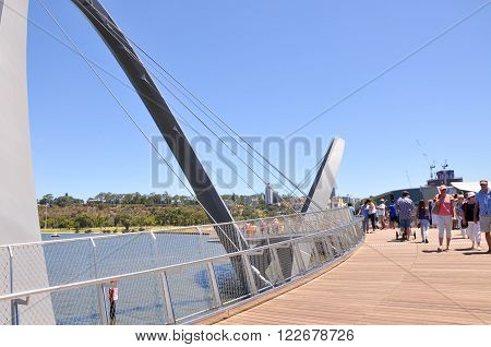 PERTH,WA,AUSTRALIA-FEBRUARY 13,2016: The Elizabeth Quay suspension pedestrian bridge over the artificial inlet with people on the Swan River in Perth, Western Australia.