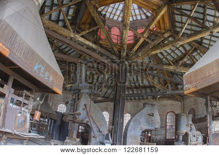 Johnstown, PA, USA - March 19, 2016:  Interior of blacksmith shop of abandoned Cambria Steel Works.