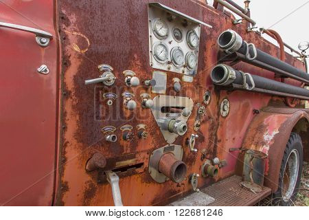 Close up of dials and controls on antique rusting fire truck.