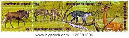 Burundi - Circa 1975: A Stamp Printed By Burundi Shows African Wild Asses, Connochaetes Gnou, Equus