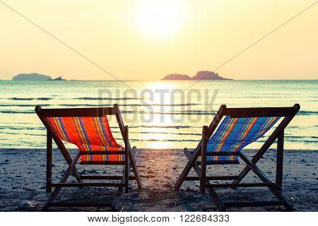 Pair of deckchairs on a Sunny beach.