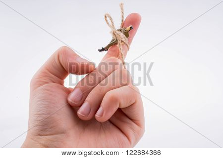 Human figure tied to a hand on a white background