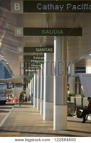 LOS ANGELES, UNITED STATES - DECEMBER 28: The walkway with digital displays of individual countries on Tom Bradley departure terminal for international flights at the airport LAX on December 28 2015 Los Angeles.