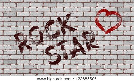 Inscription rock star on the wall of white brick