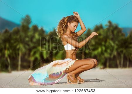 Portrait of Beautiful young woman wearing a colorfull sarong and bikini on the tropical beach