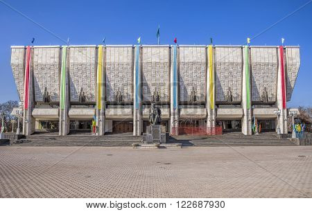 ALMATY KAZAKHSTAN - MARCH 21 2016: Kazakh State Academic Drama Theatre named after M.O. Auezov. At Theater Square is a monument M.O. Auezov.