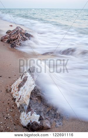 Rocks in the ocean wave Hua Hin Thailand. Long exposure photography.