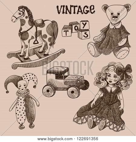 Set of vintage toys. Doll, cubes, jester, teddy bear, wooden car, rocking horse