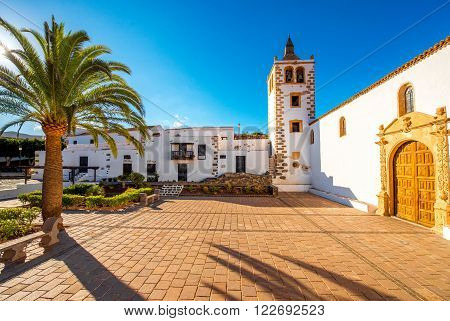 Central square with church tower in Betancuria village on Fuerteventura island in Spain