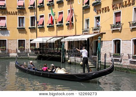 Gondolier and tourists in a gondola
