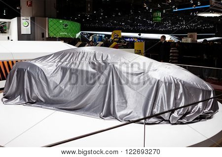 GENEVA, SWITZERLAND - MARCH 1: Geneva Motor Show on March 1, 2016 in Geneva, Techrules AT96 TREV Concept, under cover before premiere
