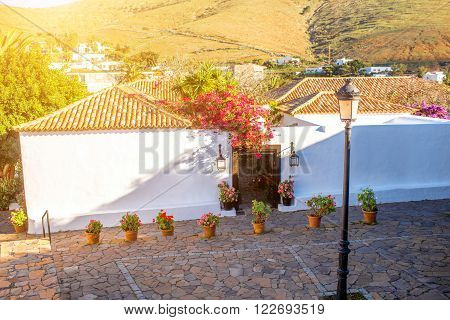 Street view with whitewashed houses in Betancuria village on Fuerteventura island in Spain