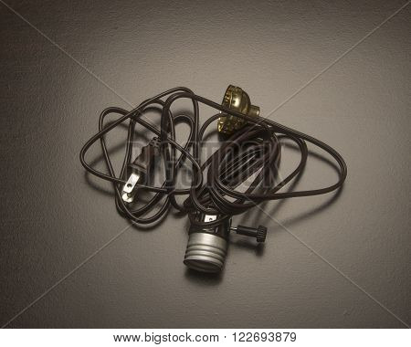 Tangled wires with a  socket for light bulbs
