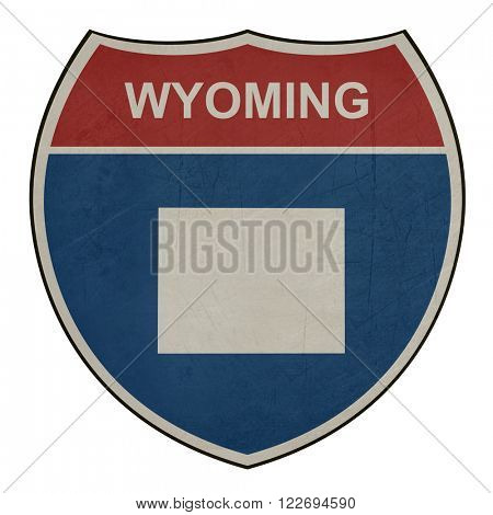 Grunge Wyoming American interstate highway road shield isolated on a white background.