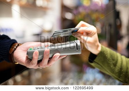 Woman pay with credit card by NFC