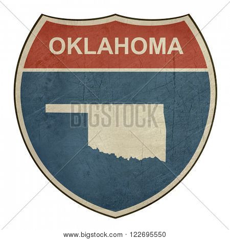 Grunge Oklahoma interstate highway road shield isolated on a white background.