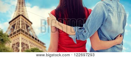 people, homosexuality, same-sex marriage, travel and gay love concept - close up of happy lesbian couple hugging over paris eiffel tower background