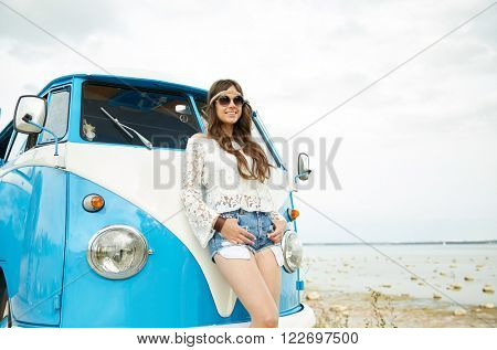 summer holidays, road trip, vacation, travel and people concept - smiling young hippie women with minivan car