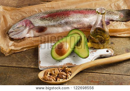 Foods Highest In Unsaturated Fat On Wooden Background.