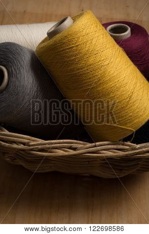 Yellow, Grey, Red, And White Thread In Basket