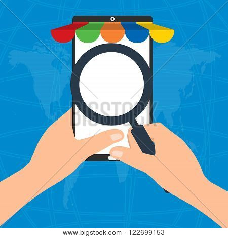 Businessman hold a magnifying glass for choosing internet online shopping on mobile tablet smart phone on world map background. E-Commerce online shopping concept.
