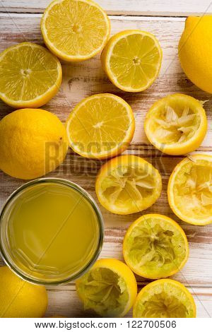 Lemon Juice In Glass Alongside Lemons