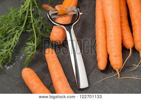 Metal Peeler Peeling A Carrot