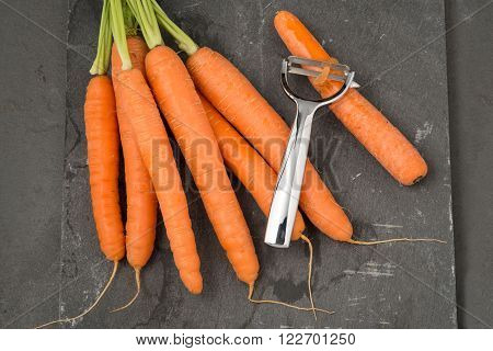 Carrots And A Metal Peeler