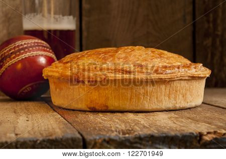 Meat Pie With Beer And Cricket Ball