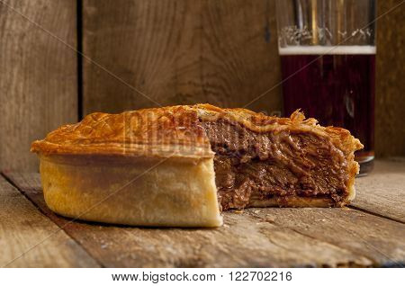 Meat Pie With Missing Slice With Beer