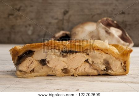 Cross Section Of Chicken And Mushroom Pie With Fresh Mushrooms