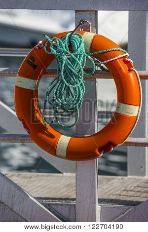 Lifebuoy on the pier in the Marina of Los Gigantes. Tenerife.