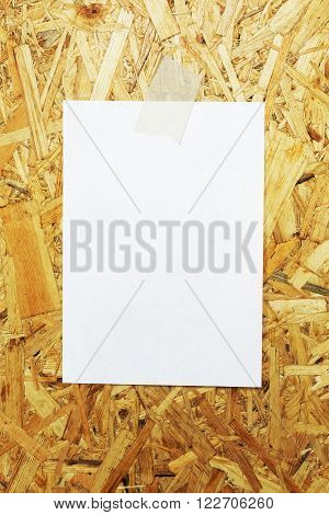 White Sheet Of Paper Glued To Plywood