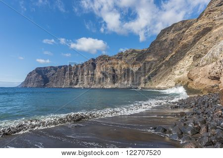 At high tide on black beach in Los Gigantes the waves wash away all that left are not experienced travelers.